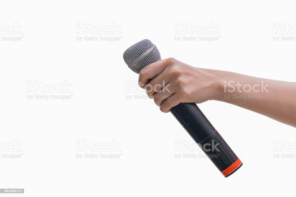 Journalist's hand Holding microphone. In the interview. news report. Black microphone. White background. - Royalty-free Adult Stock Photo