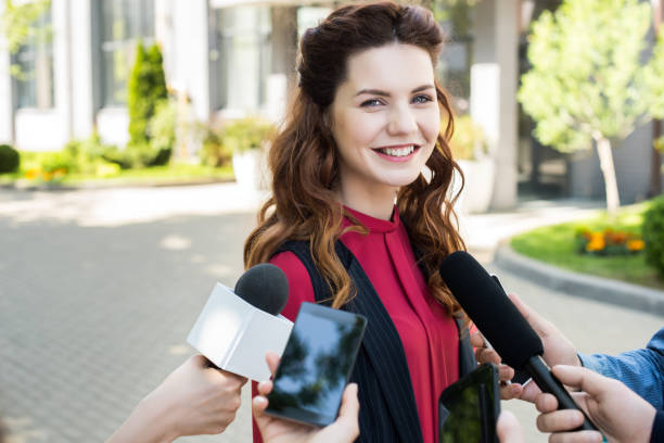 journalists interviewing public successful businesswoman with microphones and smartphones - dictaphone stock pictures, royalty-free photos & images