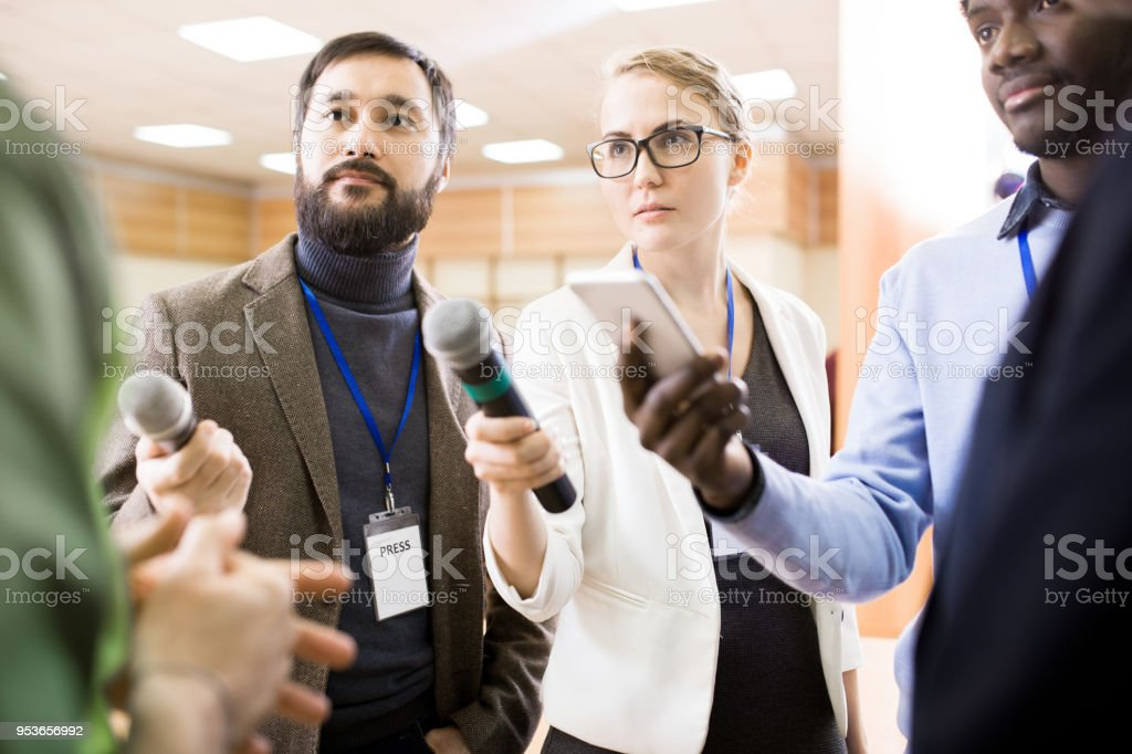 Journalists Taking Interview stock photo