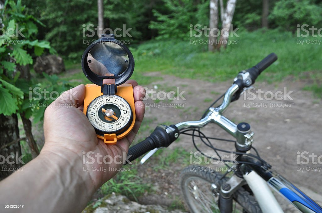 journey by bike with a compass. stock photo