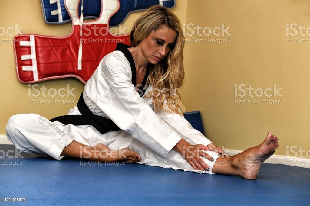 Martial artist stretching.