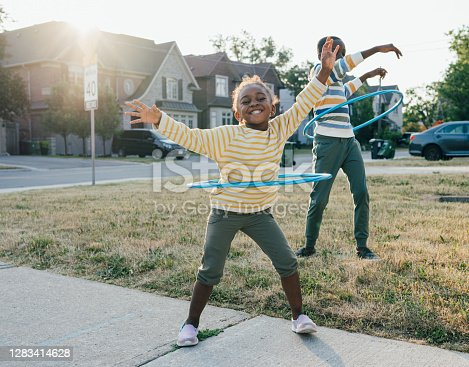 istock Joy and happiness  being outdoor with friends and siblings 1283414628