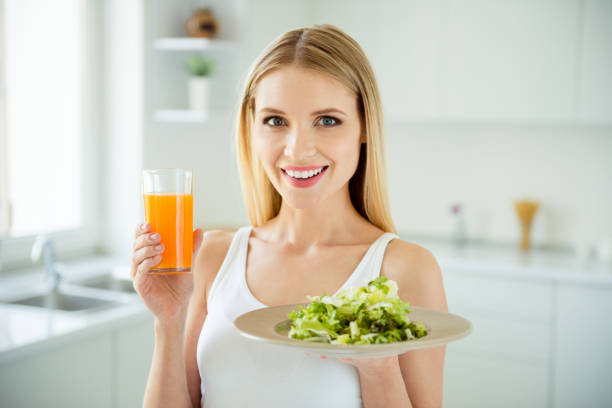 joy fun delicious appetizing low calories little bowl person concept. close up photo portrait of pretty beautiful lovely cute confident lady holding healthy food in hands white room background - kapustowate zdjęcia i obrazy z banku zdjęć