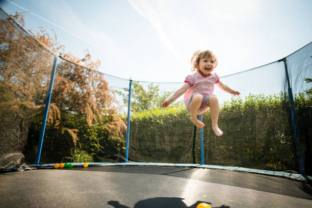 Joy - jumping trampoline stock photo