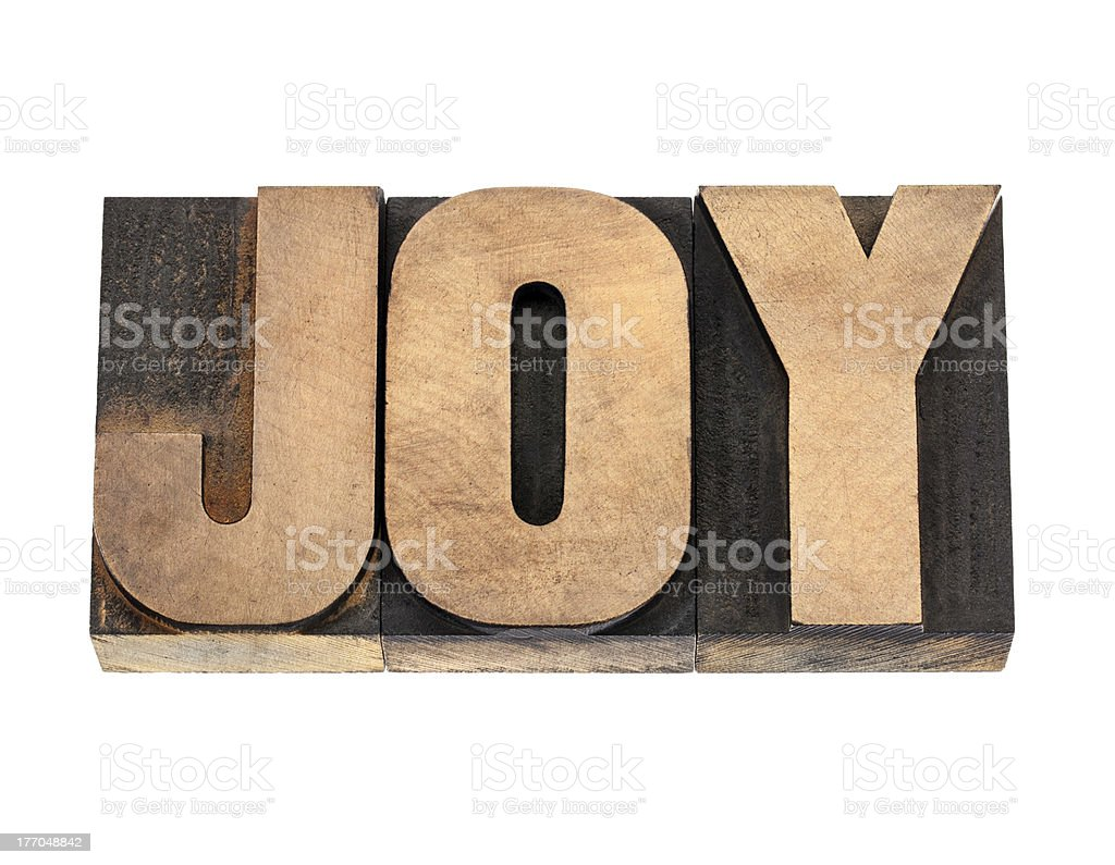 joy word in wood type stock photo
