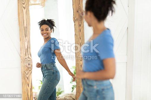 istock Joyful African American Girl After Slimming Looking In Mirror Indoor 1273277150
