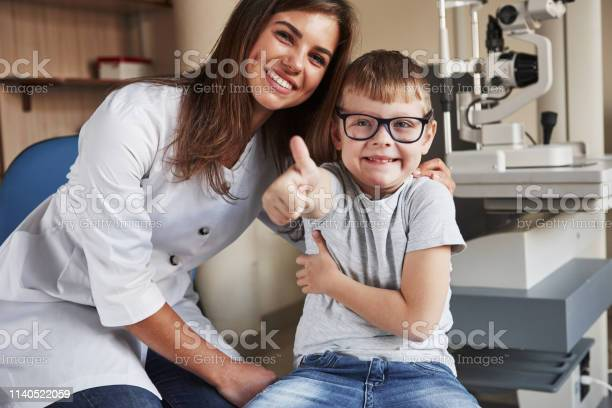 Joyful and happy female eye doctor sitting with the kid after doing picture id1140522059?b=1&k=6&m=1140522059&s=612x612&h=ridadd aplnqbe2tgkj9zhnex30rmvzhdgd8puha0ae=