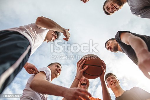 Joyful basketball team preparing to play a game