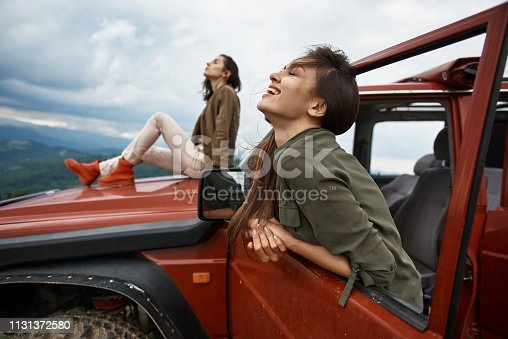 1131372580 istock photo Joyful attractive woman enjoying nature from the car 1131372580