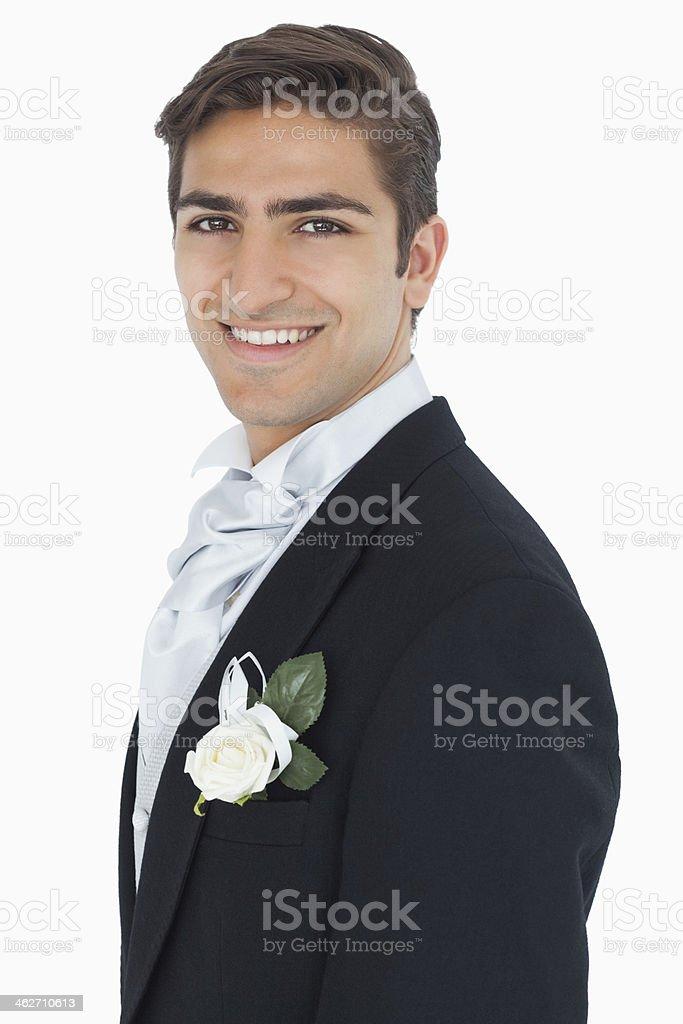 Joyful attractive young groom looking at camera stock photo
