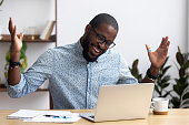 istock Joyful black businessman talking with friend make video call 1091526886