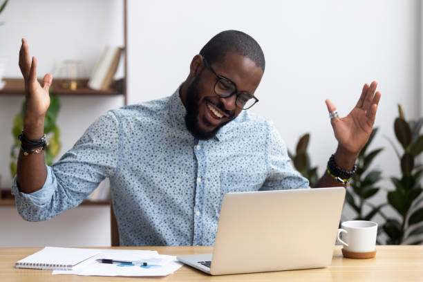 joyful black businessman talking with friend make video call - virtual meeting stock pictures, royalty-free photos & images
