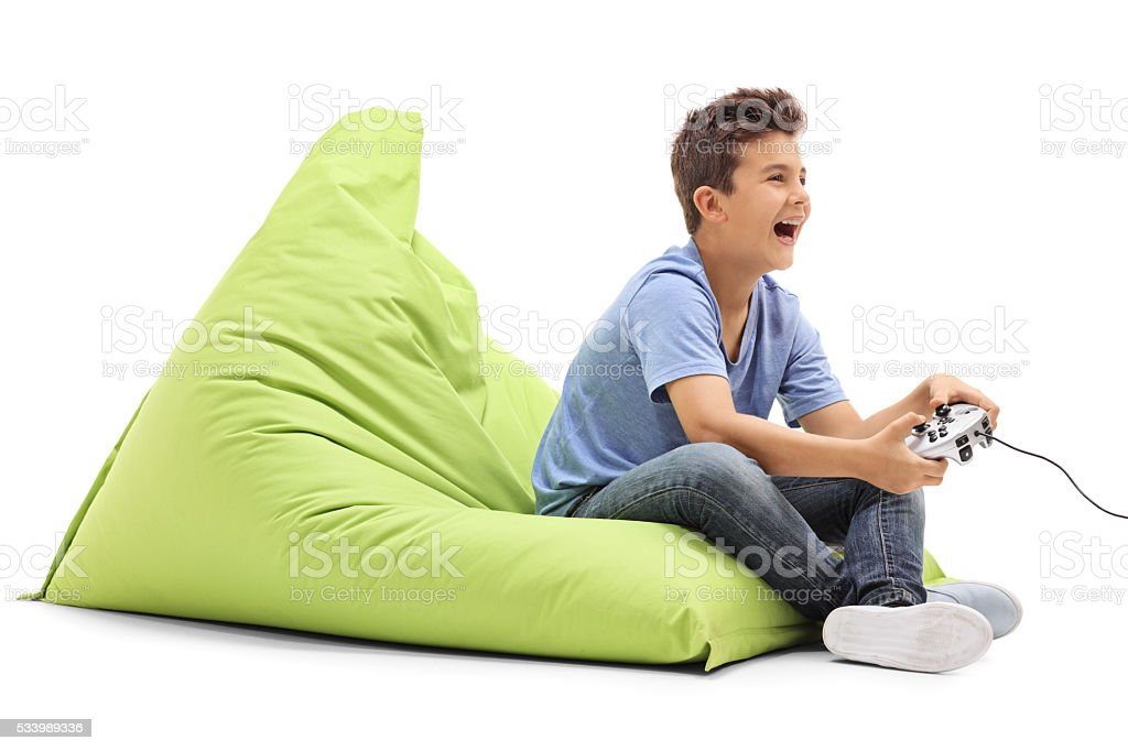 Joyful boy playing video games stock photo