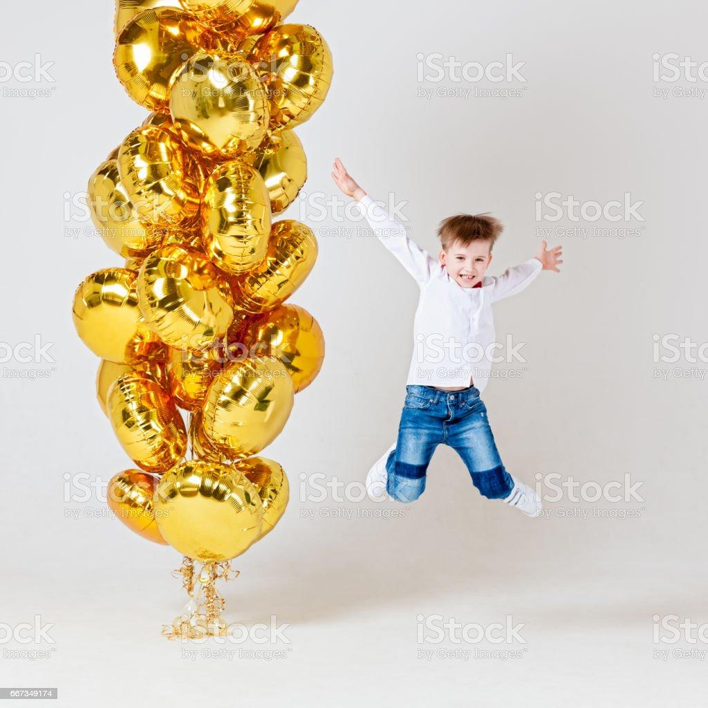 Joyful boy with balloons stock photo