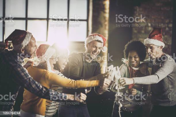 Joyful business team having fun while opening champagne during in picture id1054764244?b=1&k=6&m=1054764244&s=612x612&h=vebsrepwlqijxthr2fekxdqof2j0 ltgpvftewhihy4=