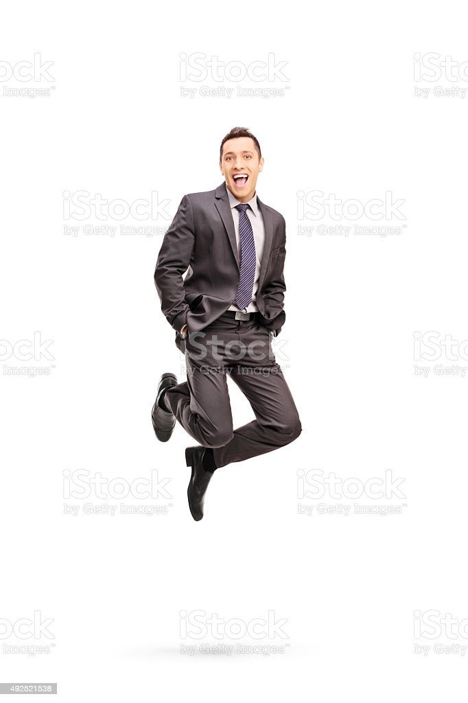 Joyful businessman jumping out of happiness stock photo