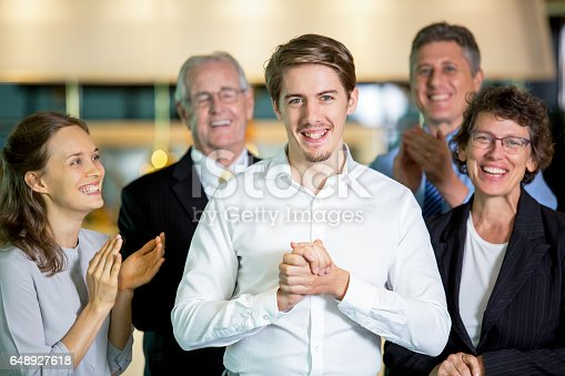 878220300 istock photo Joyful Colleagues Applauding to Happy Manager 648927618