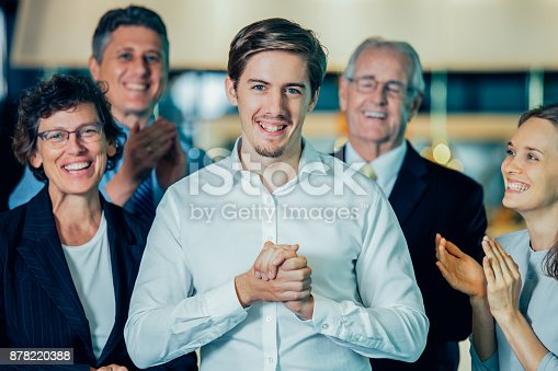878220300 istock photo Joyful Colleagues Applauding to Happy Manager 878220388