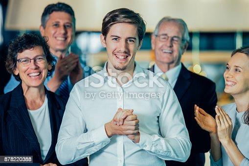 istock Joyful Colleagues Applauding to Happy Manager 878220388