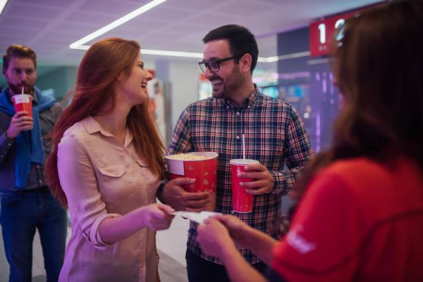 joyful couple at cinema - biglietto del cinema foto e immagini stock