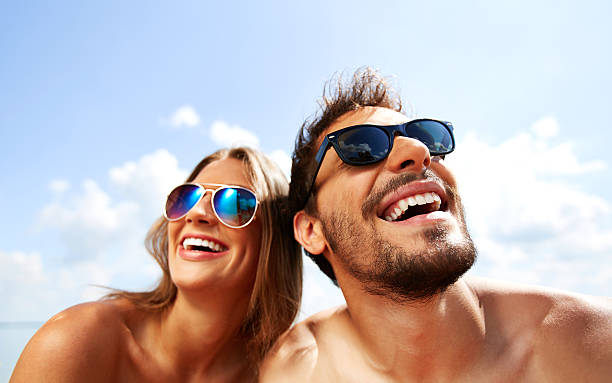 Joyful couple Relaxed young dates having fun on summer day sunbathing stock pictures, royalty-free photos & images