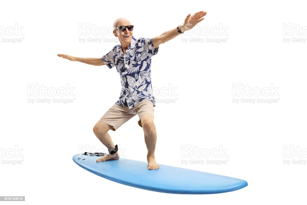 Joyful elderly man surfing stock photo