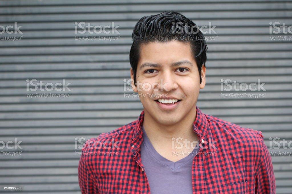 Joyful ethnic male smiling isolate with copyspace stock photo