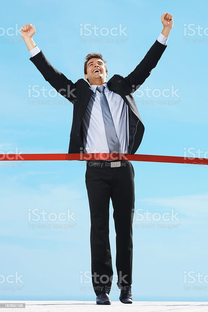 Joyful executive winning a business race royalty-free stock photo