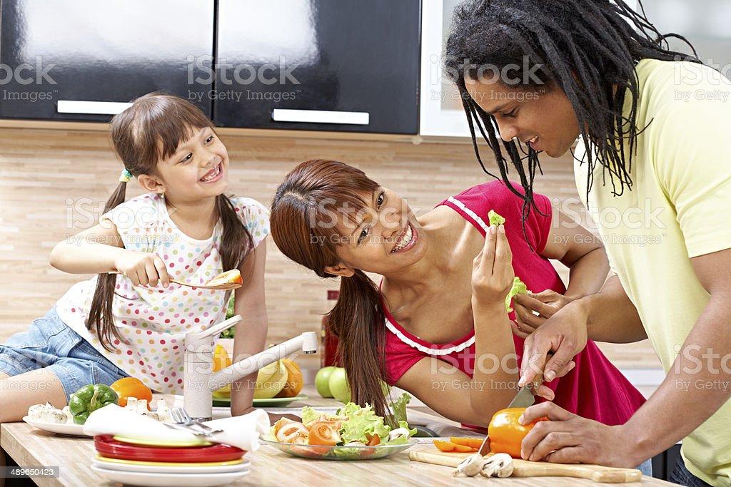 Joyful family cooking stock photo