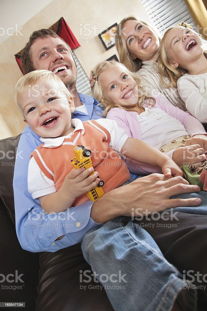 Joyful Family Enjoying Time Together in Living Room royalty-free stock photo