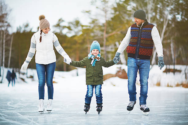 Joyful family of skaters stock photo