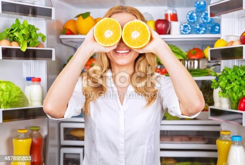 istock Joyful female on the kitchen 487695853