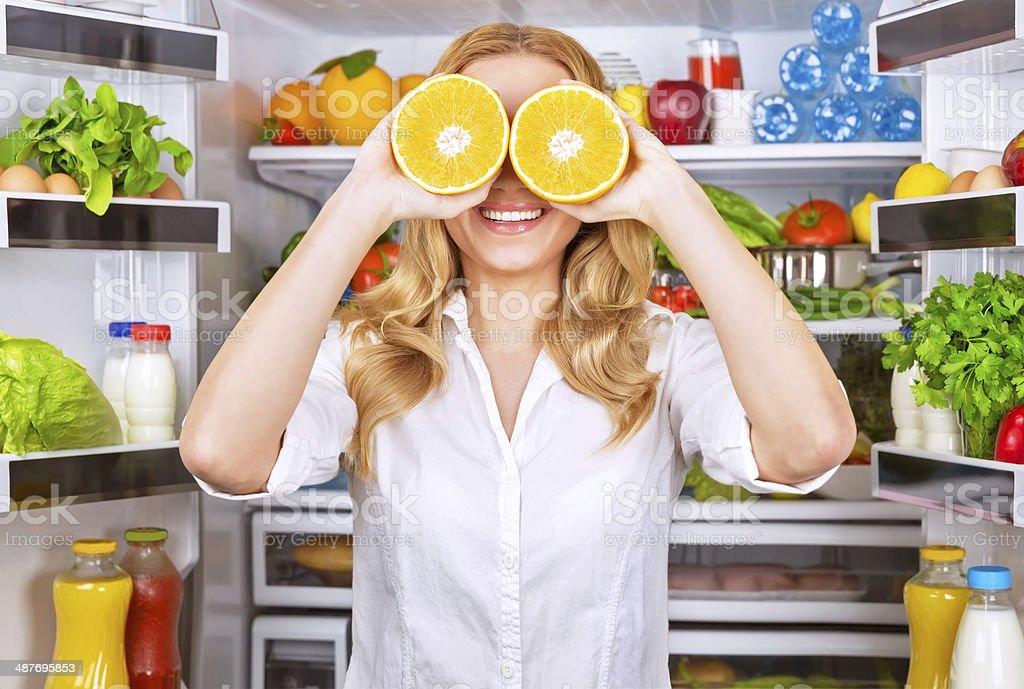Joyful female on the kitchen stock photo