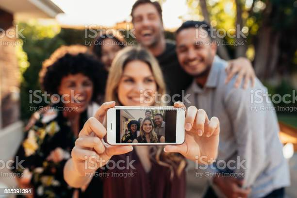 Joyful friends taking selfie during outdoor party picture id885391394?b=1&k=6&m=885391394&s=612x612&h=nvil3zb05o272zemo  ljlfuth7vycti2zx2oxul7vk=