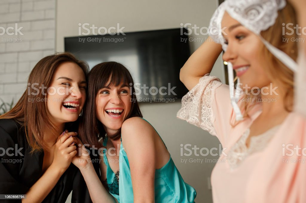 Joyful girls having fun on hen-party stock photo