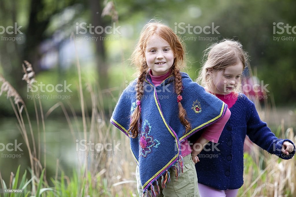 """Joyful girls in nature """"Two girls, aged 6 and 8, out in nature."""" Child Stock Photo"""