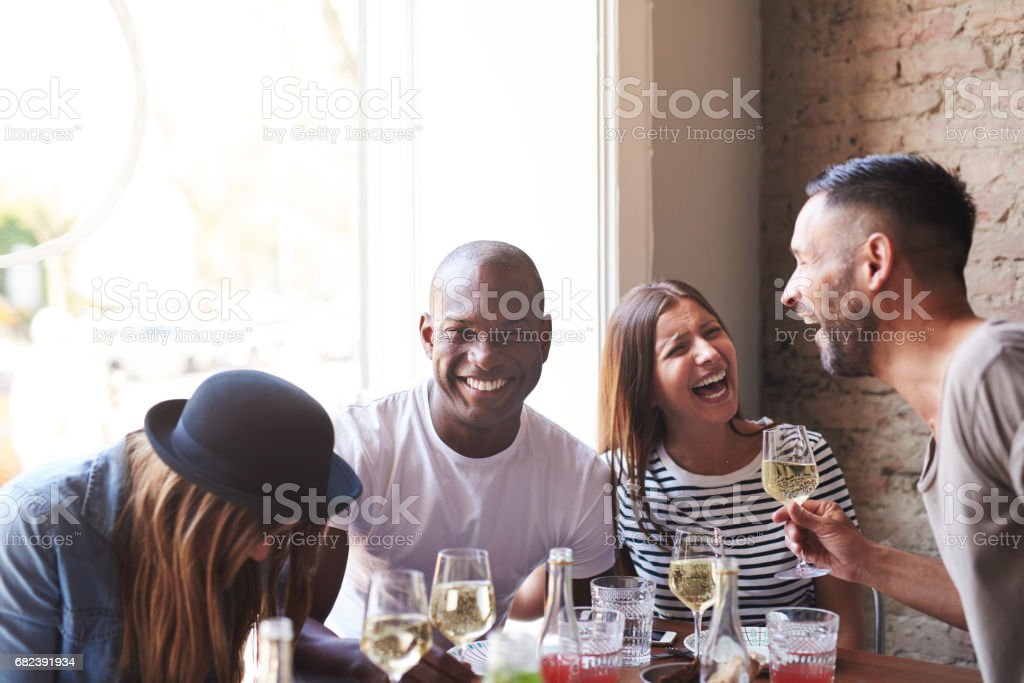 Joyful group of young adults drunk on wine royalty-free stock photo