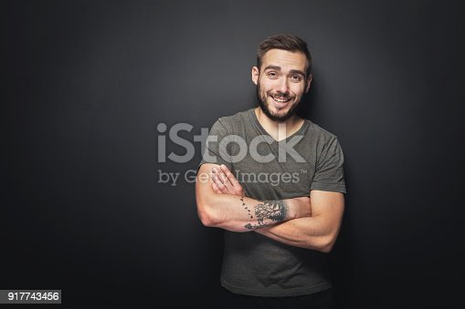 istock Joyful, handsome man on a black background 917743456