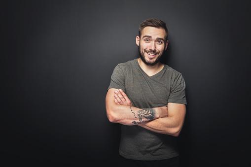 istock Joyful, handsome man on a black background 917743456