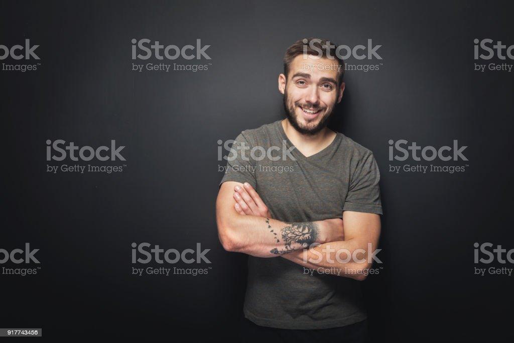 Joyful, handsome man on a black background stock photo