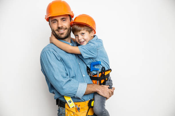Joyful handyman embracing with son stock photo stock photo