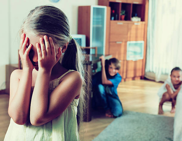 Joyful happy children hiding from girl Joyful happy children hiding from girl with closed eyes during game hide and seek stock pictures, royalty-free photos & images