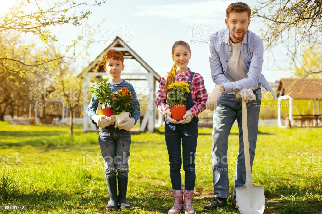 Joyful happy family looking at you royalty-free stock photo