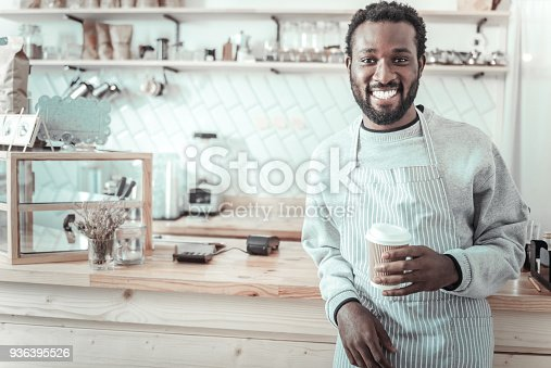 597640822 istock photo Joyful happy man holding a cup of coffee 936395526