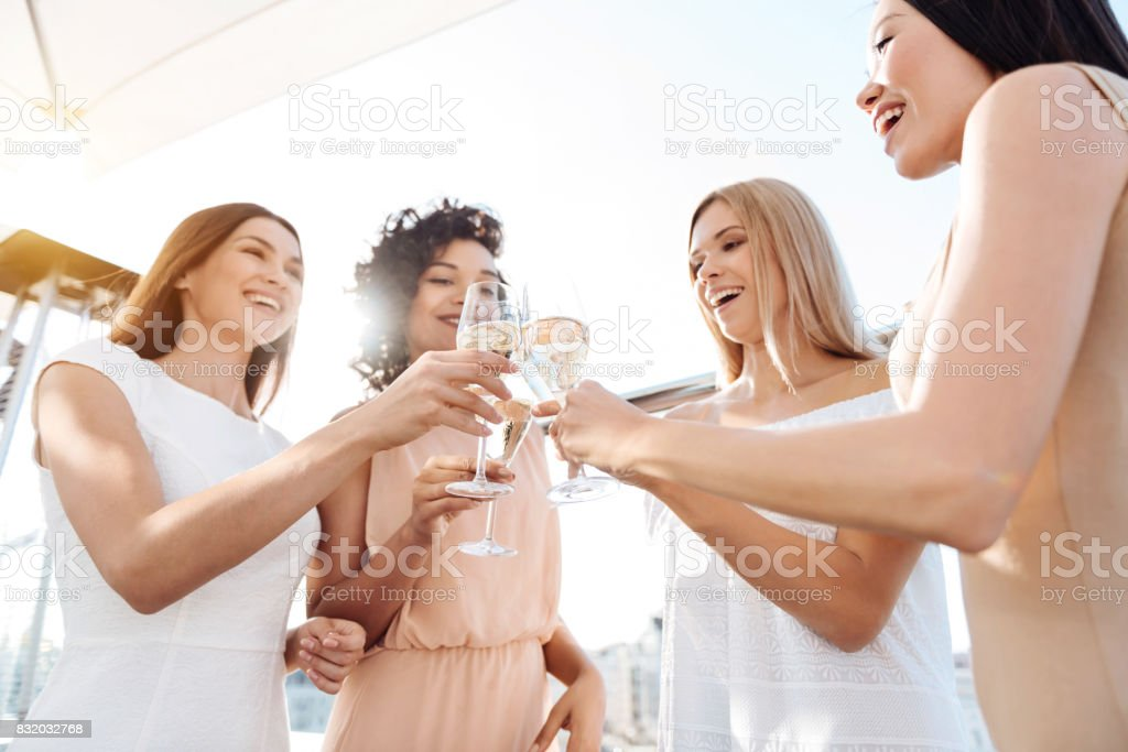 Joyful happy women having a celebration stock photo
