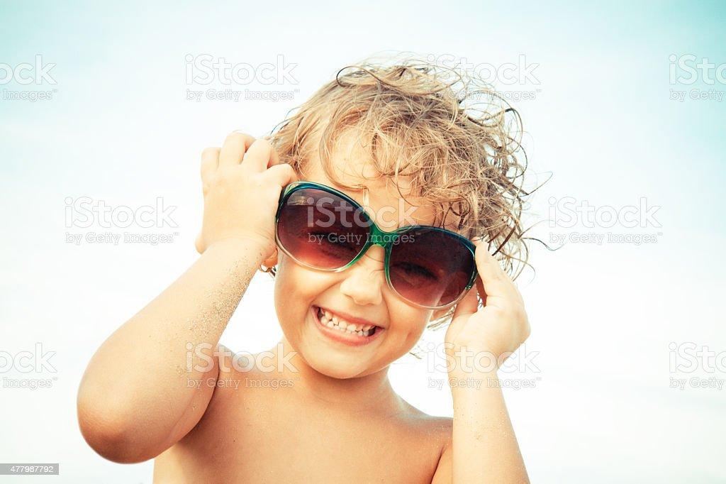 joyful little girl with glasses stock photo