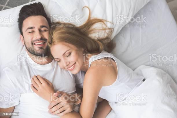 Joyful loving couple luxuriating in bedroom together picture id860618546?b=1&k=6&m=860618546&s=612x612&h=8skpfadlzrphrzyz8y q8moctyoqs r68pprrksm gw=