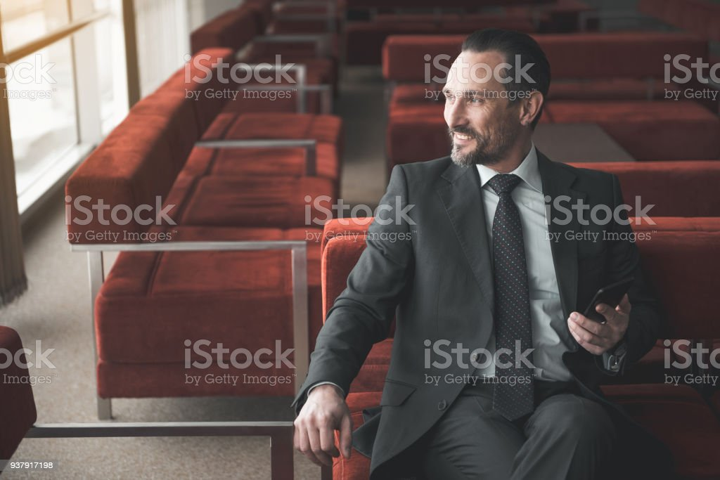 Joyful male resting after his workday stock photo