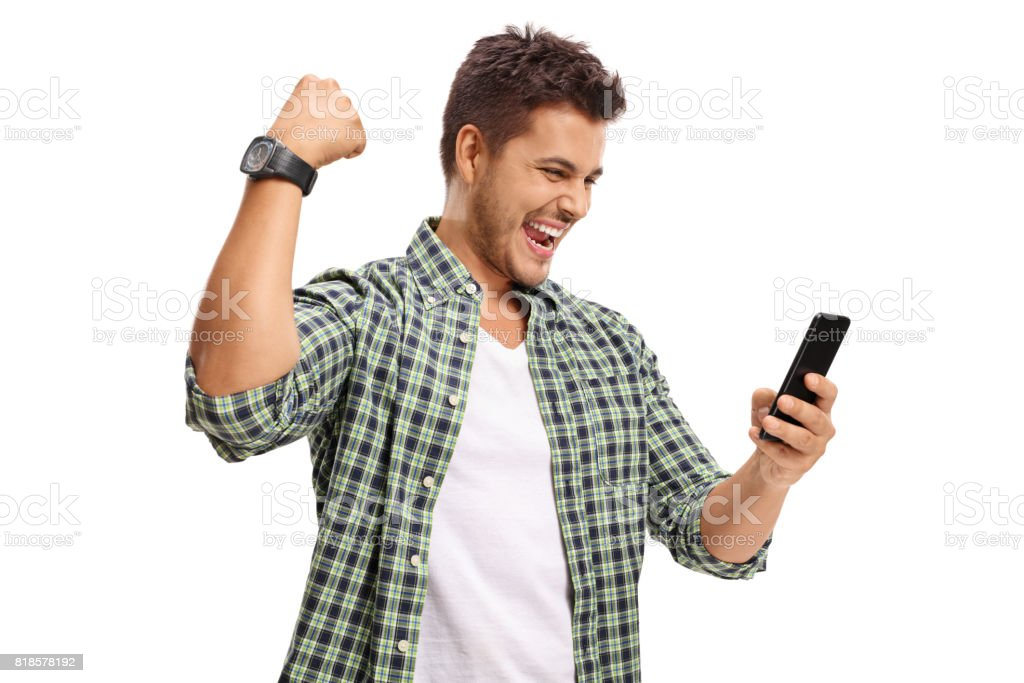 Joyful man looking at phone and gesturing with his hand stock photo