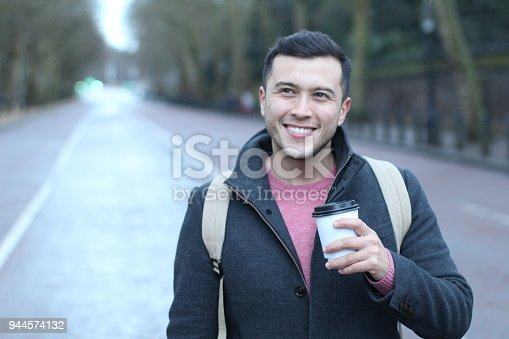 istock Joyful man starting the day with coffee 944574132